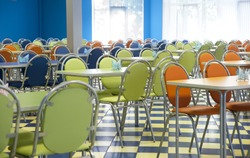 Empty cafeteria with blue, green, orange chairs
