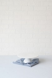 Empty Cake Stand with Blue Napkin