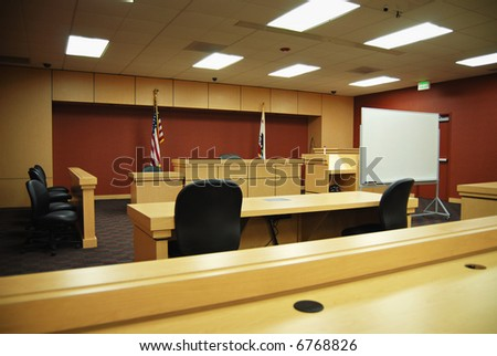Empty California courtroom with modern, sparse furnishings