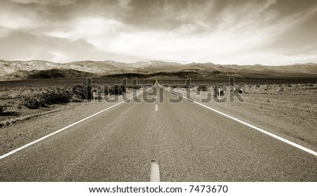 Empty californian highway through the desert