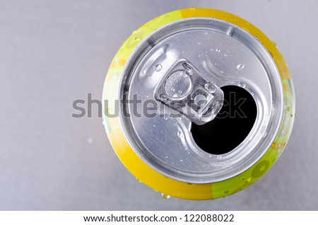 Empty can on silver background