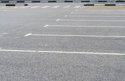 Empty car parking near shopping mall. Modern parking lot. Carpark. Empty parking spaces at the shopping centre. Public carpark. Outdoor parking.
