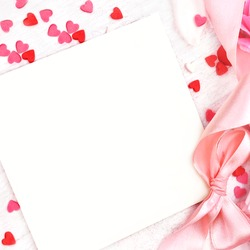 Empty card copy space on pastel pink valentine decor background, soft heart frame, toned