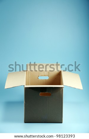Empty Cardboard Box on the blue background