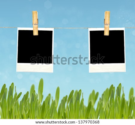 Empty cardboard tag on clothes line rope on sky background