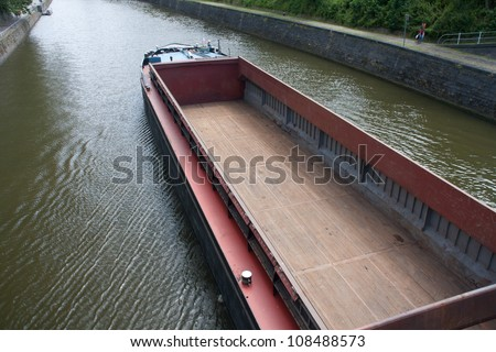 empty cargo boat on river Meuse - Namur, Belgium