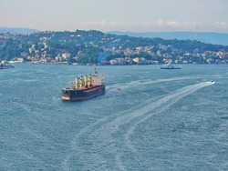 Empty cargo ship and ferry going on the bosphorus sea