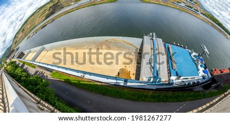 empty cargo ship at the pier in Bingen with panoramic view of river Rhine ストックフォト ©