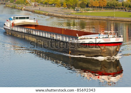 Empty cargo ship on Main River, Germany
