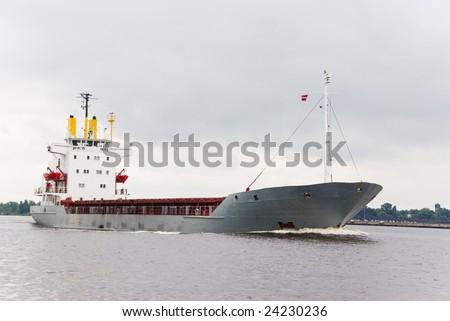 Empty cargo ship under pale gray sky