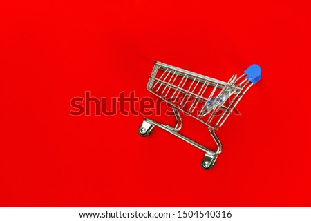 empty cart trolly for shopping product in super market and red background for texture advertising