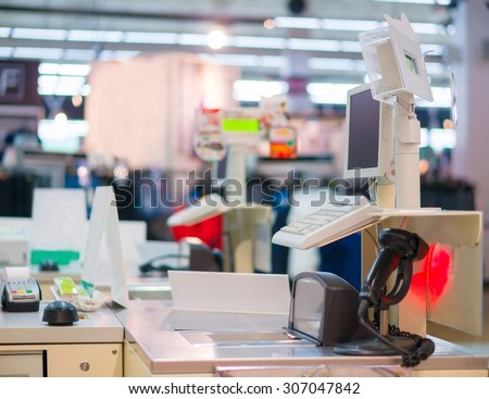Empty cash desk with computer terminal in mall