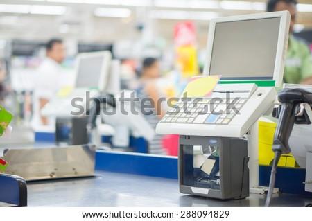 Empty cash desk with computer terminal in supermarket