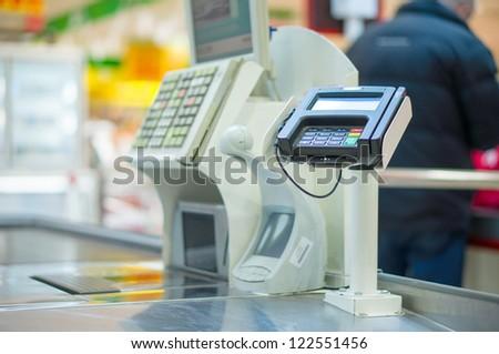 Empty Cash Desk With Terminal In Supermarket