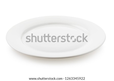 Empty ceramic plate white color, a side view of the isolated object