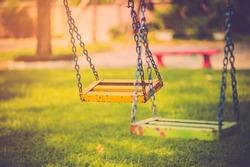 Empty chain swing in children playground