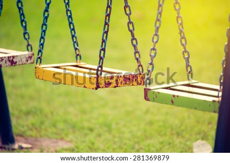 empty chain swing in playground....