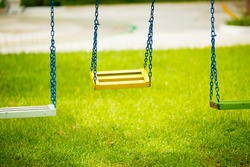 Empty chain swings in children playground