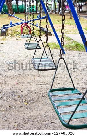 Empty chain swings on park  playground - stock photo