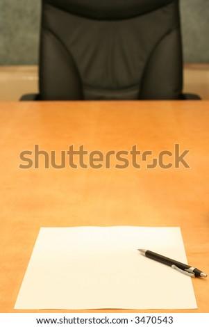Empty chair, empty paper.