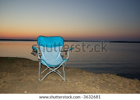 empty chair on the evening coast