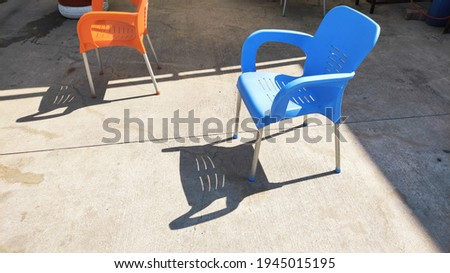 Empty chair with shadow on street Stok fotoğraf ©