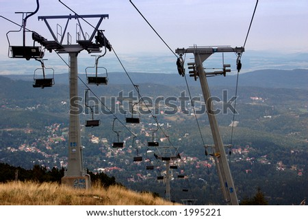 empty chair lift empty chairlift and view from the mountain on city below ez