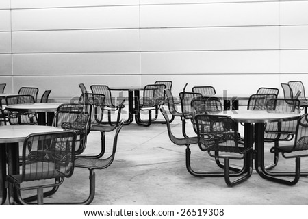 Empty chairs and tables at a restaurant