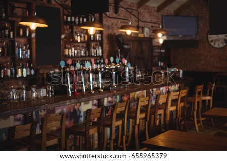 Empty chairs arranged in pub