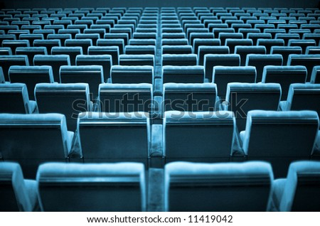 Empty chairs at cinema or theater. Blue Tone