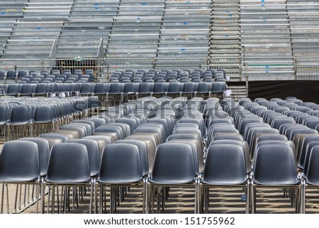 Empty chairs in an open air arena for a festival in Florence