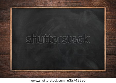 empty chalk board texture with old vintage wooden frame,blackboard concept.