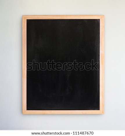 Empty chalkboard on the white  wall