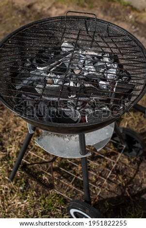 Empty charcoal grill ready for grill. Grilling outside on a barbecue grill. First outdoor grill party in spring season. Selective focus.