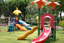 Empty Children kid playground for leisure and recreation activity with toy in the park in childhood.No entry or close in a while Coronavirus ,Prevention hygiene to stop spreading Covid-19.Stay Home.