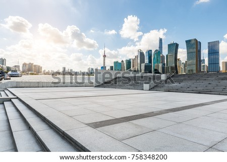 Empty city square floor and modern city commercial buildings scenery in Shanghai,China #758348200