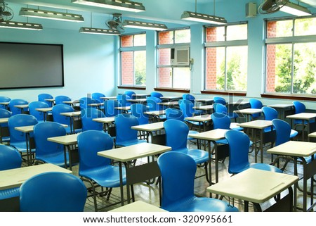 Empty classroom with desks and chairs