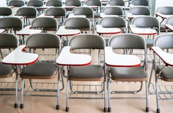 empty classroom with many armchairs