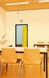 empty classroom with yellow door open