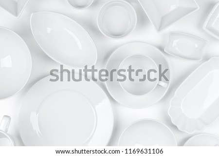 Empty, clean white assorted dishware with plates, cups and bowls white background #1169631106
