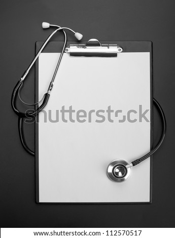 Empty clipboard with medical stethoscope