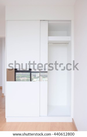 Empty Closet, Working Closet, Cupboard In Bedroom. Built In Wardrobe In A