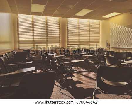 Empty college classroom at sunset #690046642