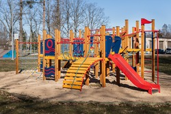 Empty colorful children playground set in park. Fun red day ice set joy kid cold baby park blue play game slide green place color climb empty child happy nobody season ladder nature ground outdoor