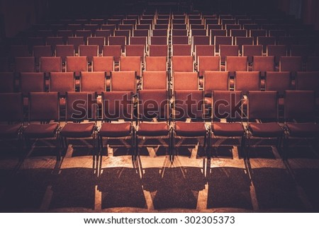 Empty comfortable red seats in a hall