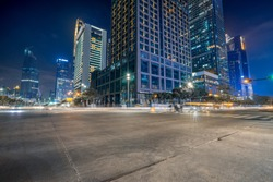 empty concrete floor and cityscape at night