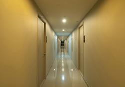 Empty condo, hotel or apartment corridor hall way in condominium building, modern interior design decoration room. Walkway