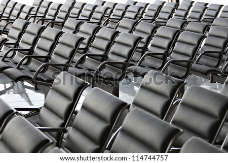 Empty Conference Hall or Waiting Space with black chairs - stock photo