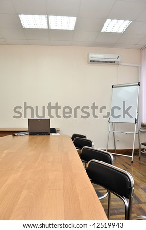 Empty conference hall with board