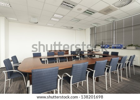 Empty conference room with huge round table